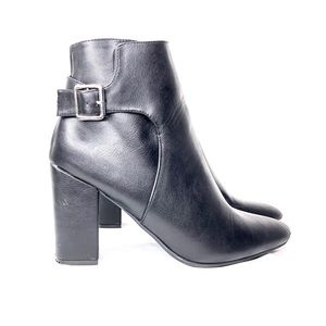 Black ankle boots with silver buckle detail